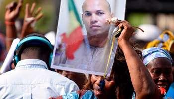Sénégal : Sall - Wade, le président et le prisonnier